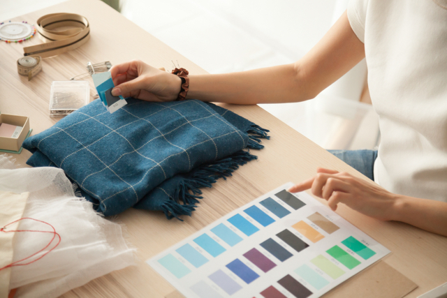 comparing textile sample to color chart